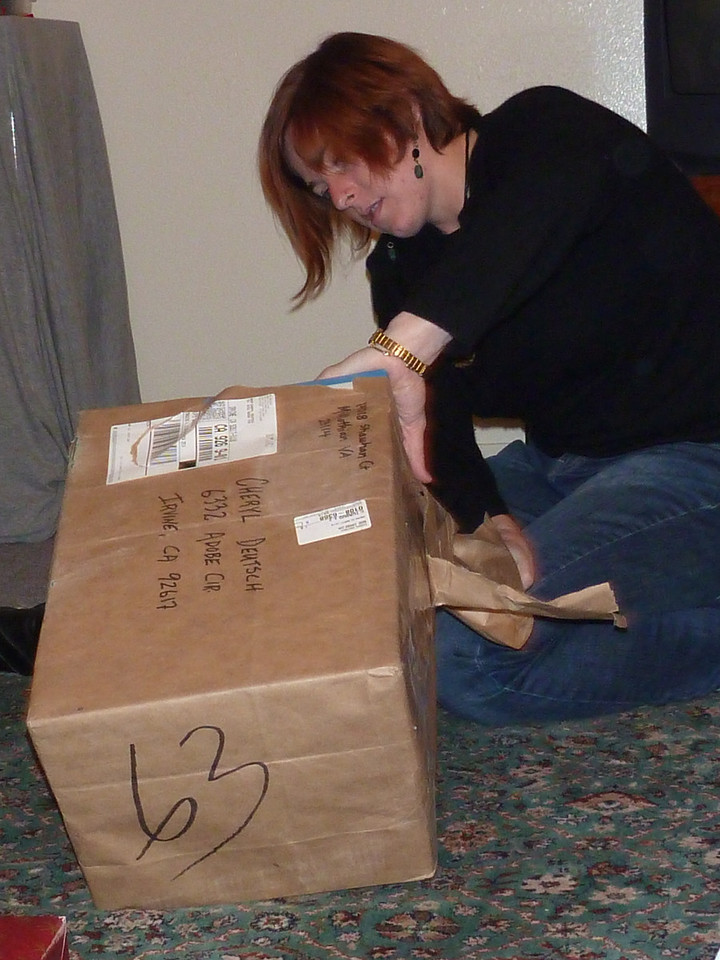 Cheryl opening the package of presents shipped to Irvine from Richmond.