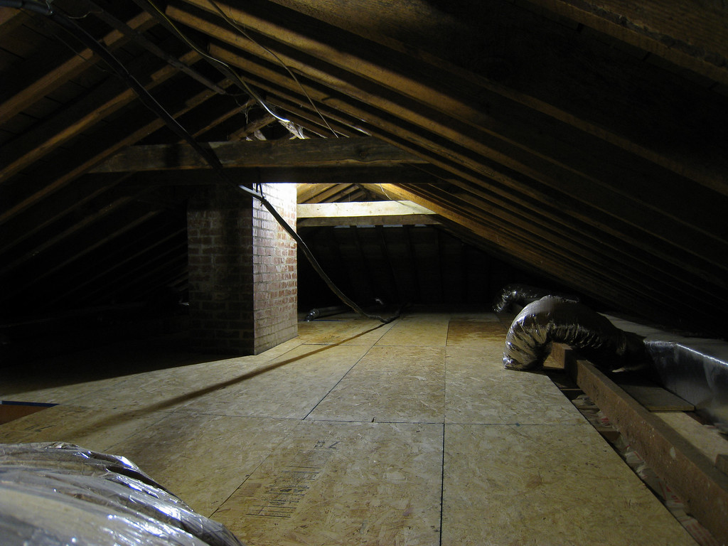 6/3/2009 - Attic with new floor and insulation looking north.