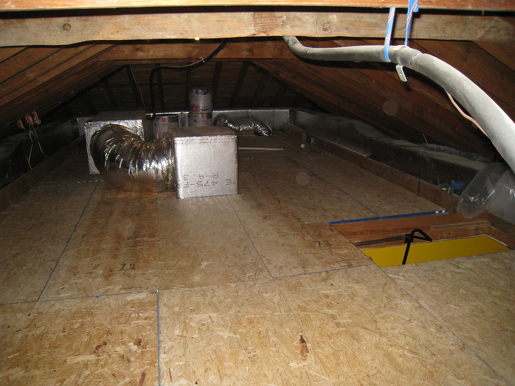 6/3/2009 - Attic with new floor and insulation looking south.