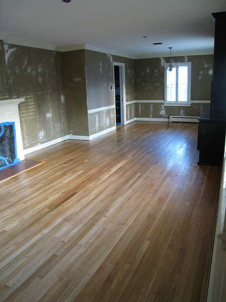 1/29/2009 - New 'natural' color of the hardwood floors with 1st coat on.