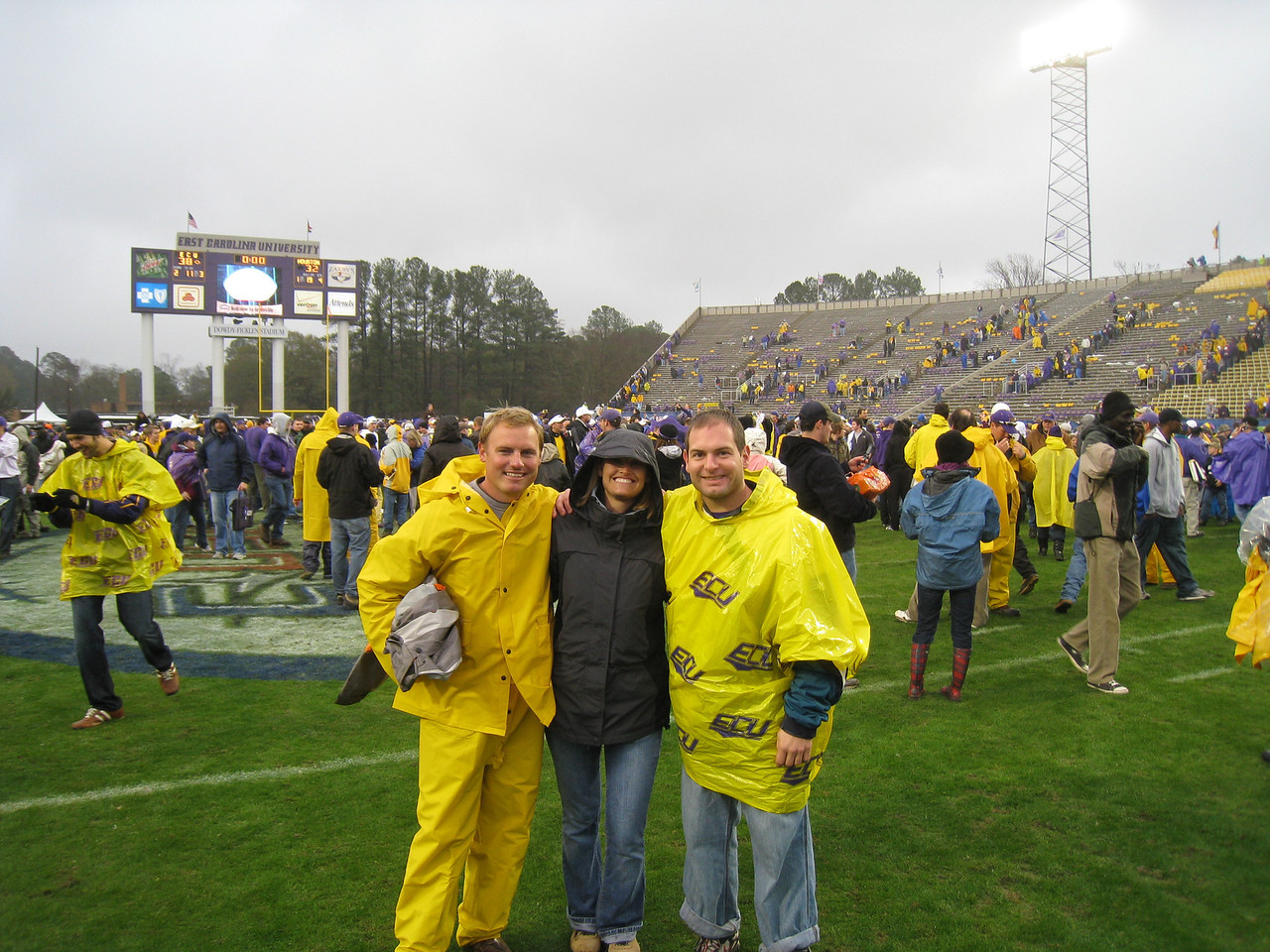12/5/2009 - Conference USA Championship Game - on the field after the game - JG Ferguson, Stephanie Eason, Jon Deutsch