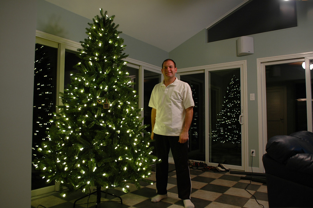 12/3/2009 - Jon Deutsch with the Christmas tree up with two ornaments.