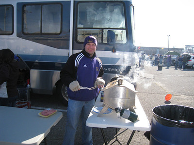 Jon cooking up some burgers during the tailgate.