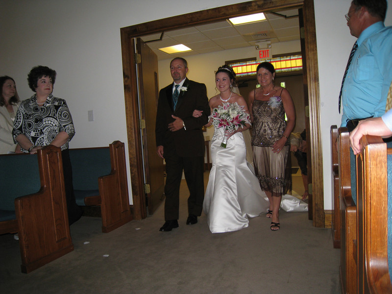 Heather walked down the isle by her parents.