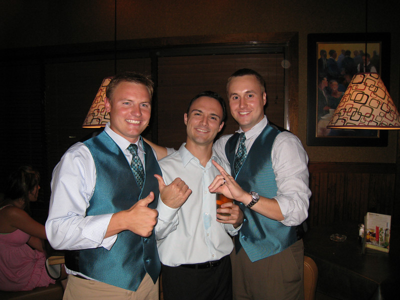 JG, Chris, Chris (JG and Chris lost a bet earlier in the night and wore their vest out the night before the wedding.)
