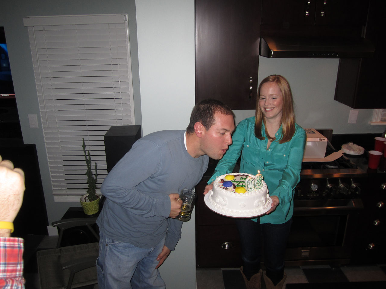 Jon blowing the candles out.