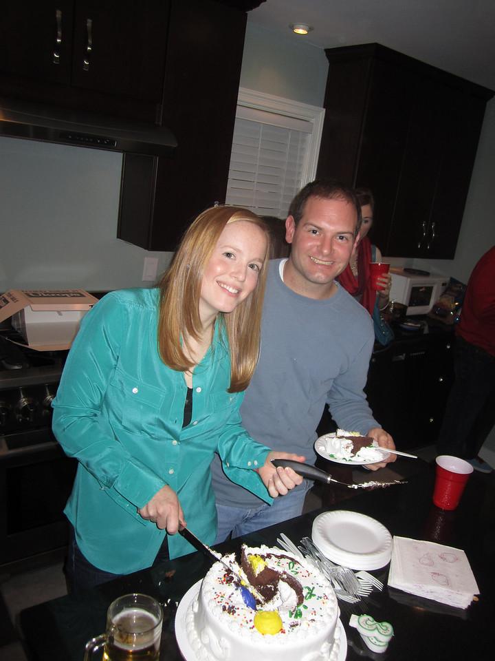 Lauren and Jon cutting cake