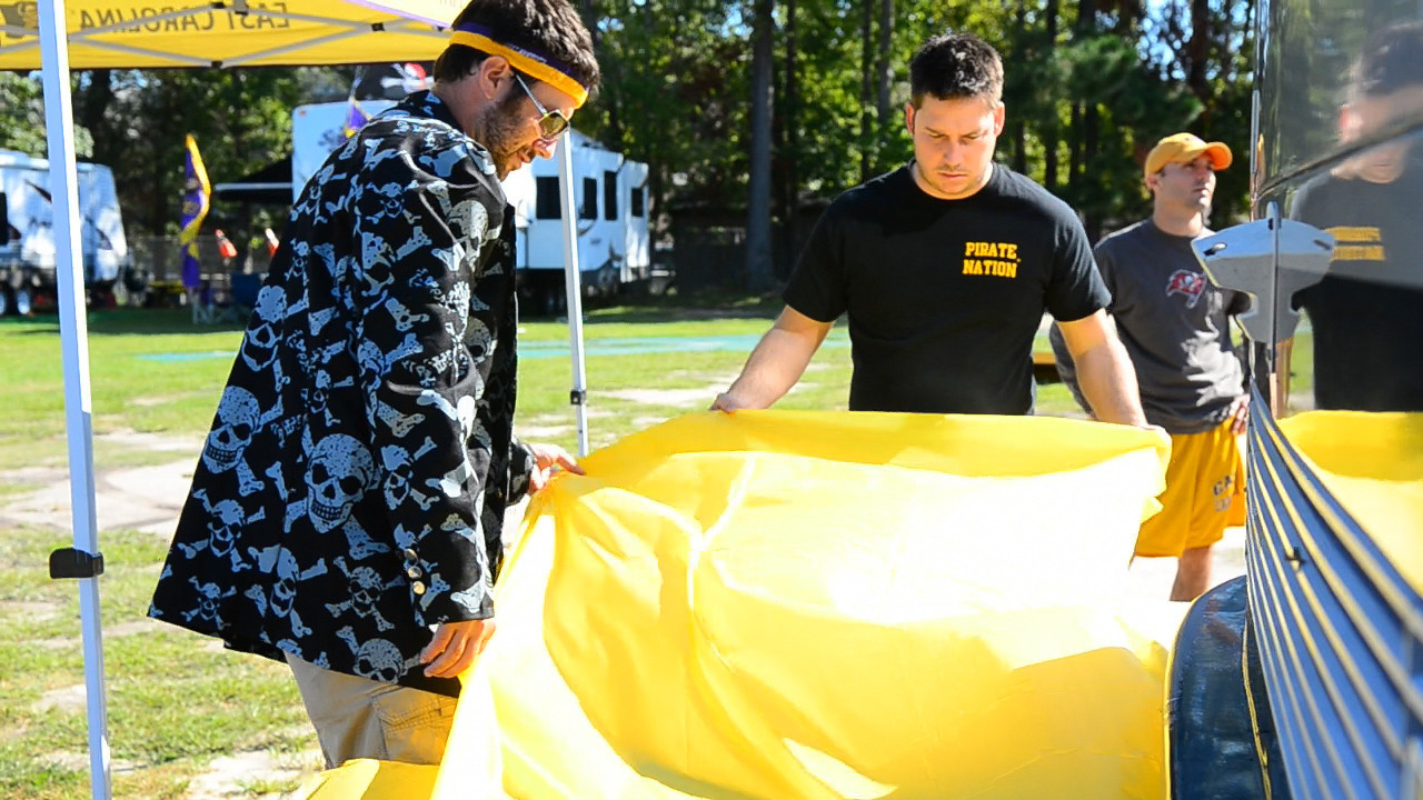 10/1/2011 ECU vs North Carolina  Preston and Chris K setting up the table cloths