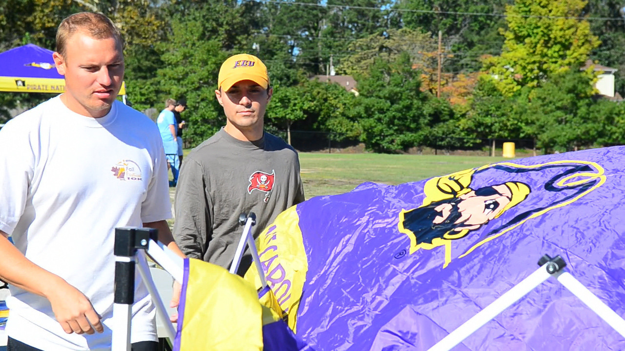 10/1/2011 ECU vs North Carolina  JG and Chris W setting up the tent