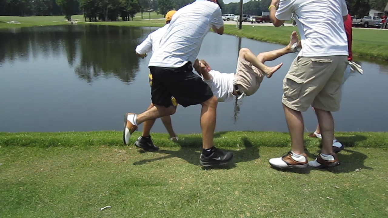 JG Ferguson gets thrown into the pond on the 10th tee