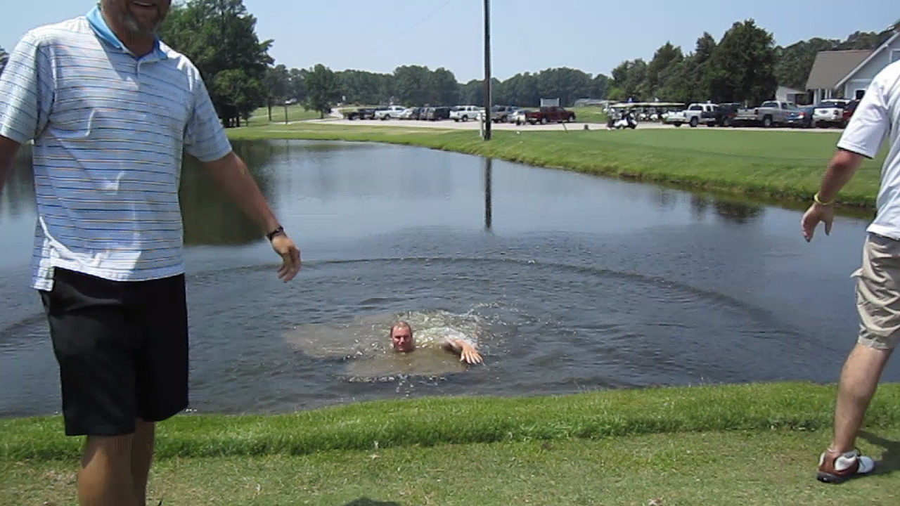 JG Ferguson in the pond on the 10th tee.