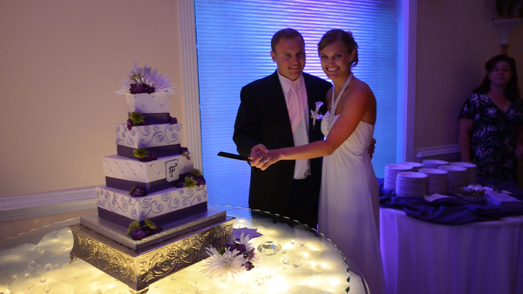 JG Ferguson and Stephanie Ferguson cutting the cake