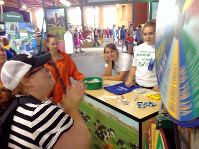 Jackie spinning the Moolette Wheel at the 2014 MN State Fair