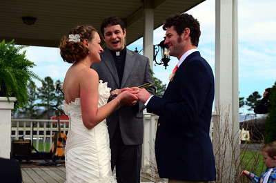 Melissa and Mark exchanging rings.