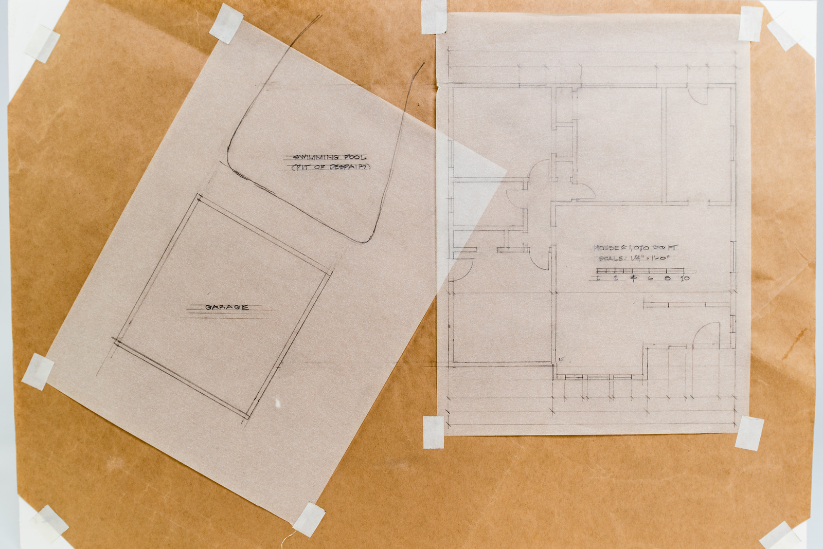 Plan view of the existing house, detached double garage and empty swimming pool.