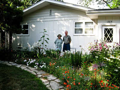 Day 1 - Karen and John Hed in their flower garden at their house in Buffalo. We stopped to visit on the way to the lake.