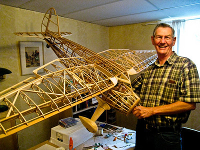 John Hed with his homebuilt balsa wood model of a 1930's Stinson Reliant