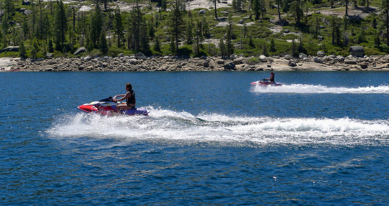 Roianne and Arianna take the funnest way possible to get from point A to B in a lake.