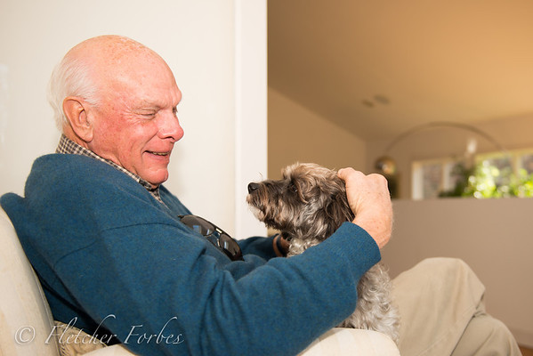 A sight I never thought I would see. John smiling at Toto.... a dog.