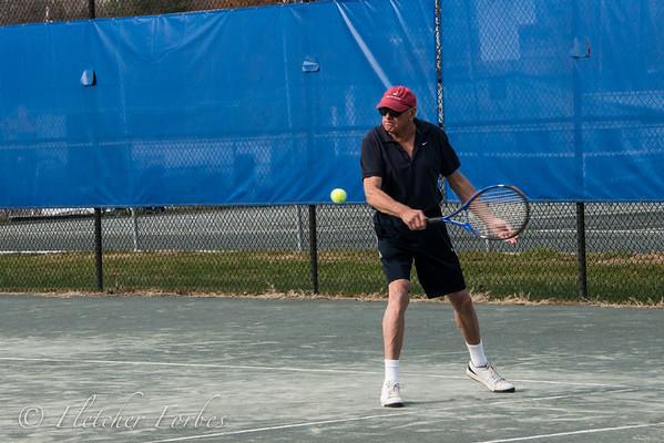 Tennis match. Contestants John, Chuck, David, and Brian.<br /> John hits a backhand