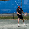 Tennis match. Contestants John, Chuck, David, and Brian.<br /> John hits a backhand