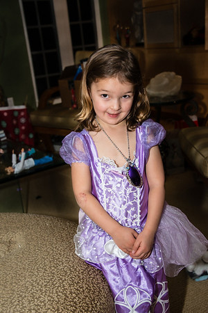 Cali in her princess dress with her amethyst amulet.