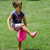 Emmi Rappa, 5, mimicks frisbee tricks during a workshop taught by Todd Brodeur, of World Class Frisbee Shows, at Thayer Memorial Library in Lancaster on Thursday, July 20, 2017. SENTINEL & ENTERPRISE / Ashley Green