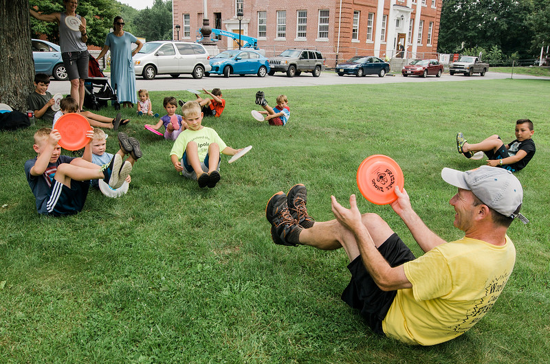 Todd Brodeur, of World Class Frisbee Shows, teaches tricks to children at Thayer Memorial Library in Lancaster on Thursday, July 20, 2017. SENTINEL & ENTERPRISE / Ashley Green