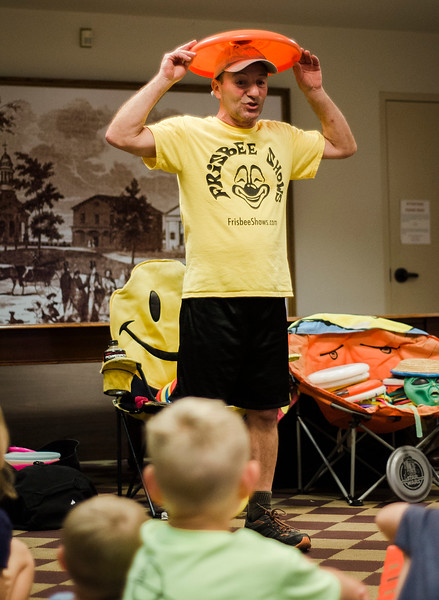 Todd Brodeur, of World Class Frisbee Shows, performs tricks for children at Thayer Memorial Library in Lancaster on Thursday, July 20, 2017. SENTINEL & ENTERPRISE / Ashley Green
