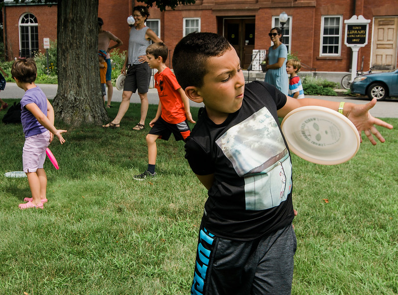 Eli Rappa, 7,  mimicks frisbee tricks during a workshop taught by Todd Brodeur, of World Class Frisbee Shows, at Thayer Memorial Library in Lancaster on Thursday, July 20, 2017. SENTINEL & ENTERPRISE / Ashley Green