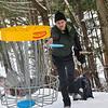KRISTOPHER RADDER — BRATTLEBORO REFORMER<br /> Jim Olson, of Brattleboro, toss the frisbee into the basket during a round of frisbee golf at Living Memorial Park, in Brattleboro, on Thursday, Jan., 2, 2020.