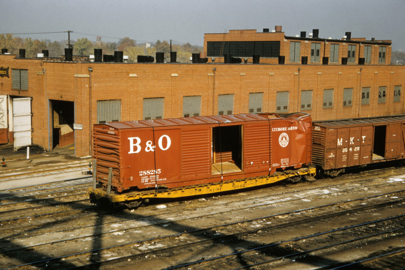 SLSF 92 - Oct 31 1957 - B&O boxcar on flatcar in Linderwood Yards St Louis MO