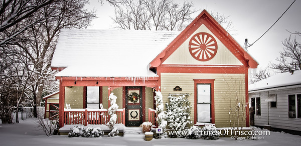 A charming, snow covered cottage in old Downtown Frisco.