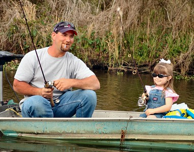 Father and Daughter Fishing along Bayou Petit Caillou