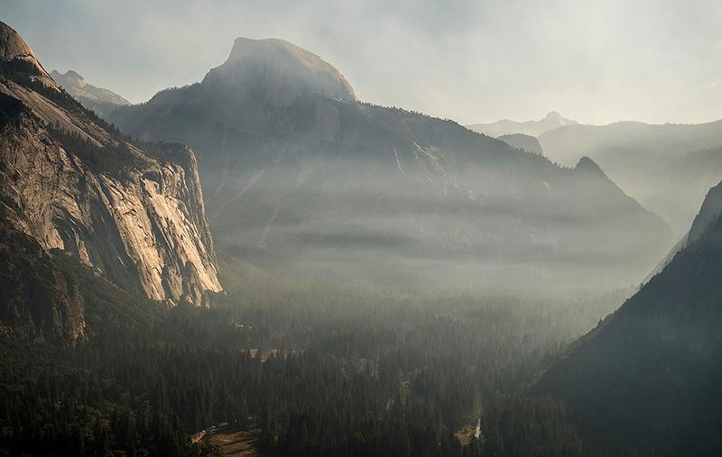 Half Dome and smoke from the Empire fire, Yosemite, California, USA