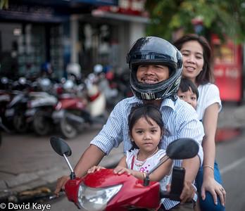 motorbike family - 4 riders, 1 helmet...