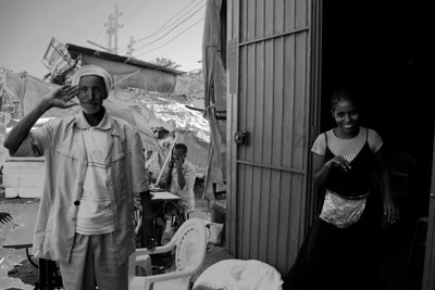 In Bahir Dar's market, a father and embarrassed daughter take a break from their stall