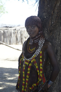 The Hamer tribe (4 photos).  The jewellery around the neck shows that this woman is a first wife (men of the Hamer tribe can have two wives).  Lucky husband...