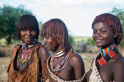 ...these 3 women are (from left to right) a first wife, a second wife and unmarried...