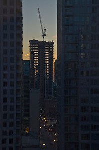 Zooming in on high rise construction at dawn, looking east (3)