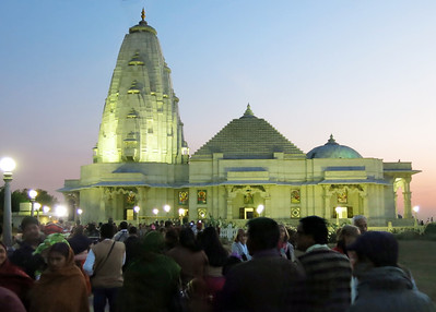 Crowds flock to the modern Birla temple at sunset.