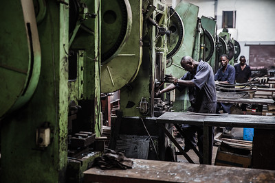 Workers in a leaf springs plant in Nairobi, Kenya.