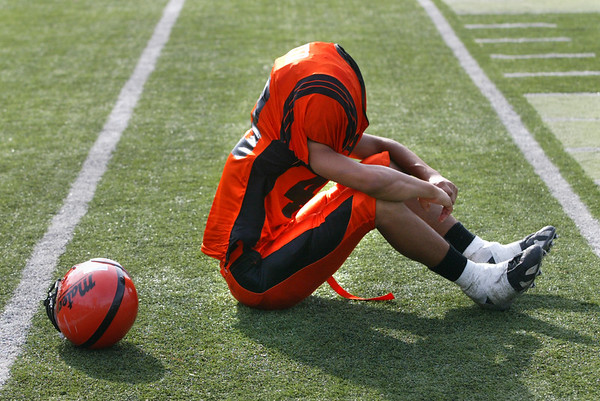 john green/staff 11/12/05 smc times news San Mateo  player Kenneth Easter, sits dejected after the Beacats lost to Burlingame in the Little Big Game Saturday. Burlingame edged San Mateo, 24-23 .