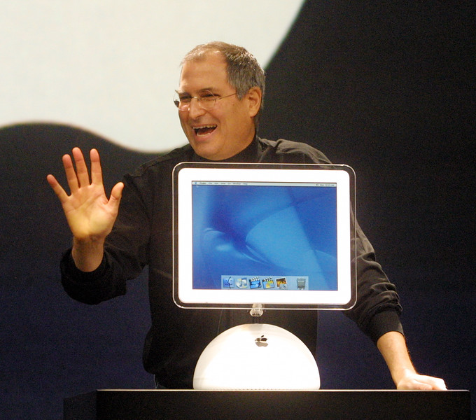 john green/staff 1/7/02 smc times business Apple Computer CEO Steve Jobs introduces the new I Mac computer at the MacWorld Expo at the Moscone Center in San Francisco Monday morning.