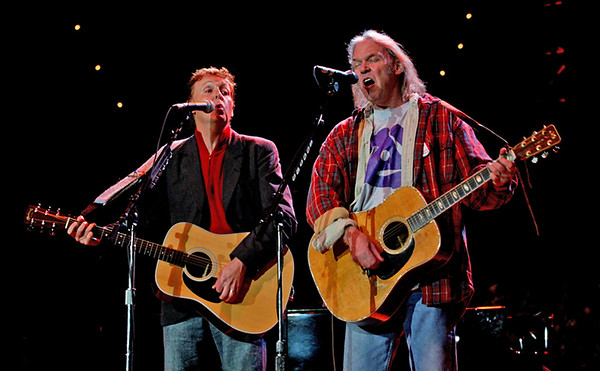 john green/10/24/04 Paul McCartney(left) and Neil Young perform at the Bridge Concert,Saturday night at the Shoreline Amphitheater.