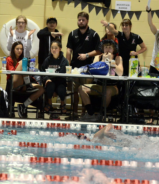 Loveland's Ella Doerr (bottom) is cheered on by coaches and teammates as she goes after the state cut in the 100-yard freestyle at Saturdays' finals of the Front Range League Championships at Veterans Memorial Aquatics Center in Thornton. (Mike Brohard/Loveland Reporter-Herald)