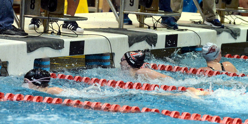 Loveland's Adley Morrison touches at the finish of the B final of the 50-yard freestyle at Saturdays' finals of the Front Range League Championships at Veterans Memorial Aquatics Center in Thornton. (Mike Brohard/Loveland Reporter-Herald)