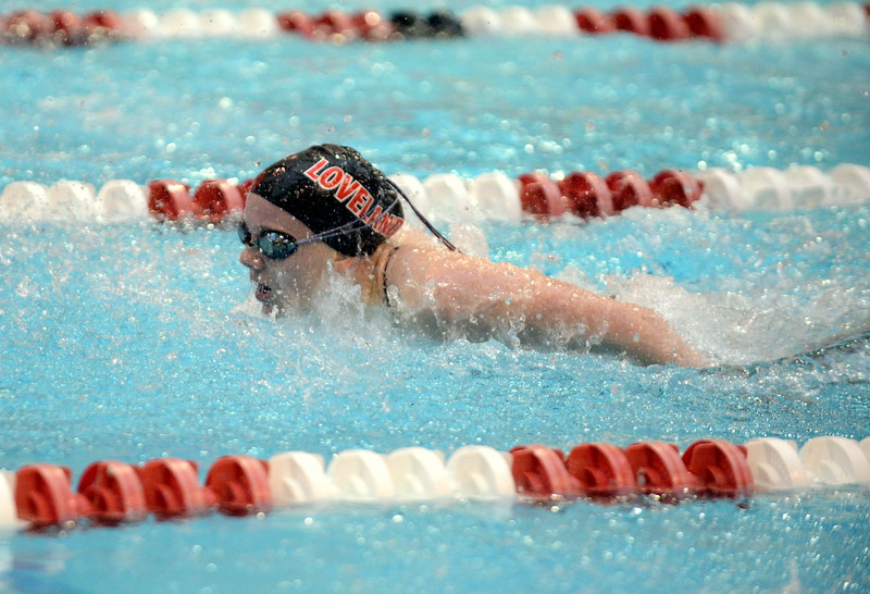Loveland's Jordan Reichhardt competes in the C final of the 100-yard butterfly at Saturdays' finals of the Front Range League Championships at Veterans Memorial Aquatics Center in Thornton. (Mike Brohard/Loveland Reporter-Herald)