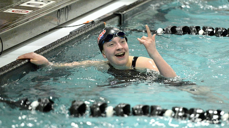 Loveland's Delaney McNally is all smiles after winning the C final of the 100-yard breaststroke during Saturday's Front Range League Championships at the Mountain View Aquatic Center. McNally lowered her seed time for the state meet with a 1:11.85.
