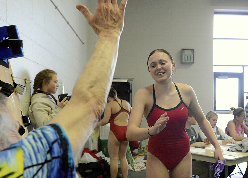 Fairview diver Rya Muller is congratulated by her coach after her first dive of the finals during Saturday's Front Range League Championships at the Mountain View Aquatic Center. Muller placed third with a score of 424.85.